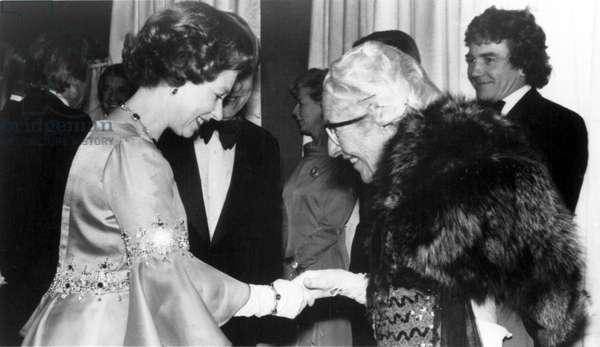 Queen Elizabeth II & Dame Agatha Christie at Royal performance of MURDER ON THE ORIENT EXPRESS, 1974. Albert Finney is in the background.