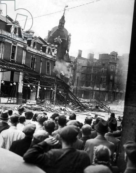 World War 2, Battle of Britain. Londoners watch the demolition of historic Smithfield Market's tower during the Blitz. April 1941