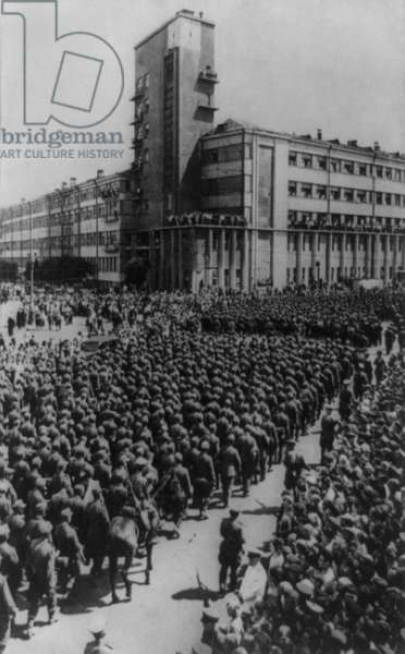 World War 2 German prisoners paraded through Moscow in 1944. Near the People's Commissariat of Communications, Soviet workers watch and jeer German generals and soldiers taken prisoners on the Byelorussian front in 1944