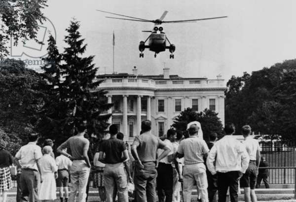 President John Kennedy's new helicopter takes off from the South Lawn. JFK flew over tourists on this way to the Governors' Conference in Philadelphia. July 4, 1962