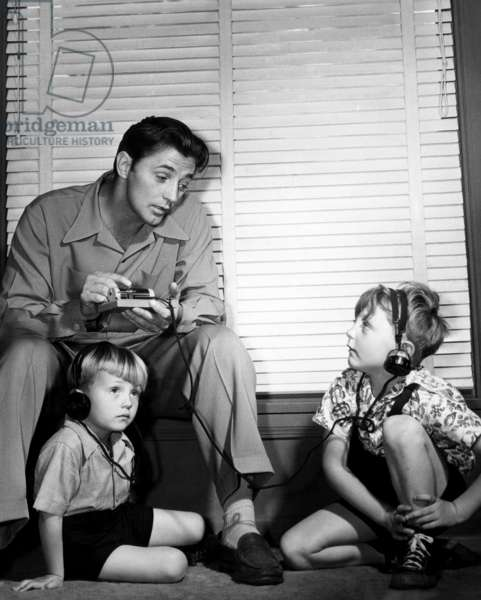 Robert Mitchum (top left), and his sons, Chris Mitchum (left), and Jim Mitchum (right), c.1947