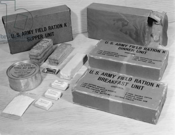 World War 2 'K Rations' issued to U.S. soldiers in emergencies and continuous combat. The three meals, weighs only 2 pounds and contained 3,000 calories. The contents included crackers, canned meat, chocolate, sugar, powdered beverage packet, and cigarettes and matches