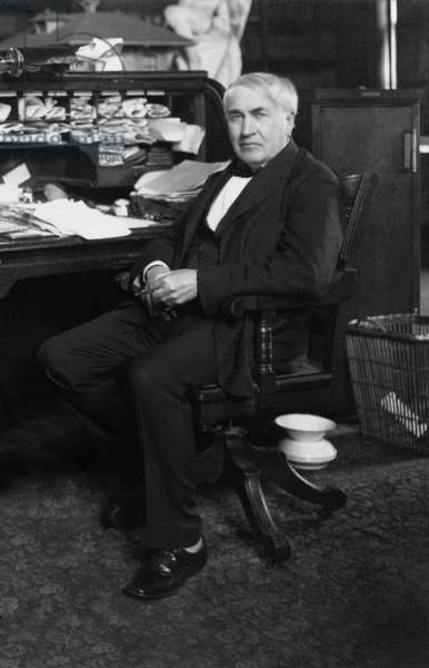 Thomas A. Edison (1847-1931) at his desk in his West Orange, New Jersey, laboratory, c. 1913