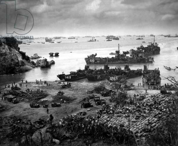 Landing craft of supply U.S. forces on Okinawa, 13 days after the initial invasion. Beyond are U.S. battlewagons, cruisers and destroyers. April 13, 1945. World War 2