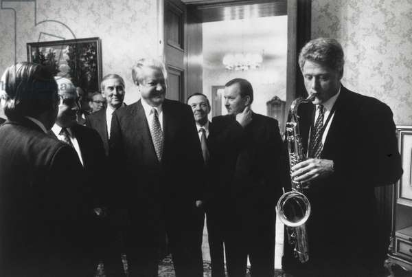 President Bill Clinton plays the saxophone presented to him by Russian President Boris Yeltsin. Yeltsin hosted a private dinner at Novoya Ogarova Dacha, Russia. Jan. 13, 1994