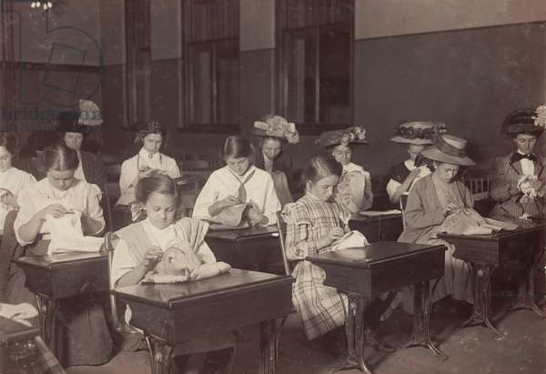 Learning to embroider in the free evening school, Boston Massachusetts, photograph by Lewis Wickes Hine, October, 1909