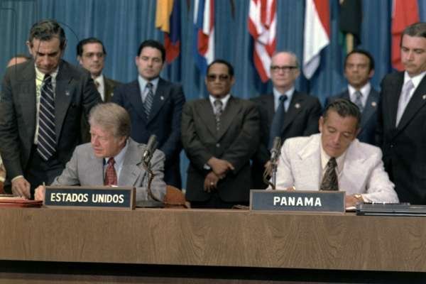 President Jimmy Carter and General Omar Torrijos signing the Panama Canal Treaty. Washington, D.C., September 7, 1977