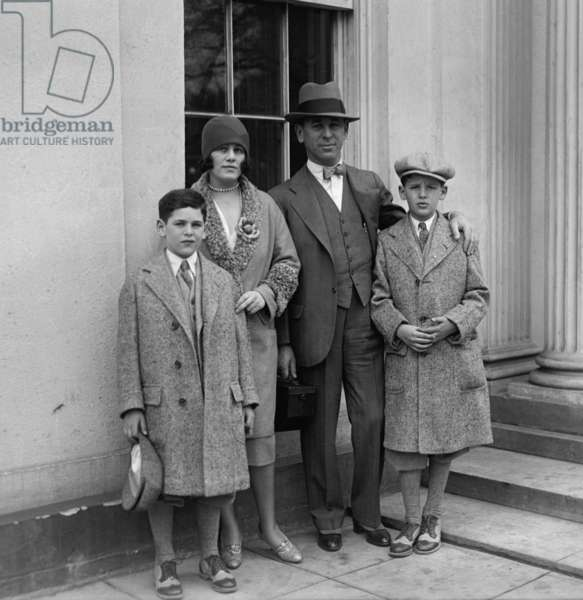Rube Goldberg (1883-1970), with his family, wife Irma Seeman, Thomas and George. April 4, 1929. The cartoonist depicted Rube Goldberg machines, exceedingly complex contraptions designed to accomplish simple tasks
