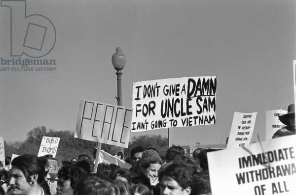 March on the Pentagon. Some of the 100,000 protesters at the Lincoln Memorial hold signs protesting the Vietnam war. Oct. 21, 1967