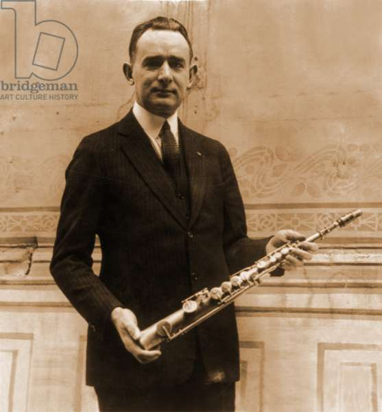 Tomm Brown, one of the six members of the Brown Brothers claimed to have had the first all saxophone act, posed with 1st saxophone made by its inventor, Adolph Sax. 1922