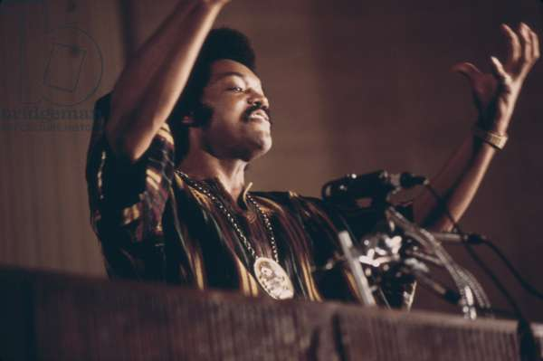 Jesse Jackson speaks on a radio broadcast from the headquarters of 'Operation Push' during its annual convention July 1973