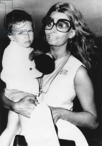 Sophia Loren holds her son, Carlo Ponti, Jr., at Rome's Leonardo da Vinci Airport. July 31, 1970