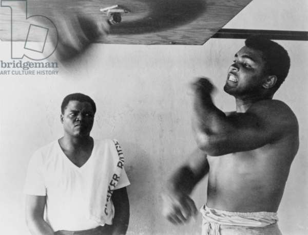 Muhammad Ali, works out on light bag in Miami, Florida. 1965