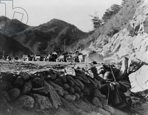 U.S. 3rd Army Division patrol pinned down by Chinese fire from the hills as they protect a convoy under attack in north-east Korea 1950. Korean War, 1950-53