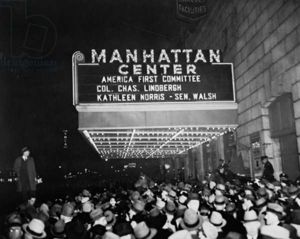 Crowd beneath Manhattan Center marquee for 'America First Committee'. April 4, 1941. Listed speakers are Col. Charles Lindbergh, Popular author Kathleen Norris, and Senator David Walsh