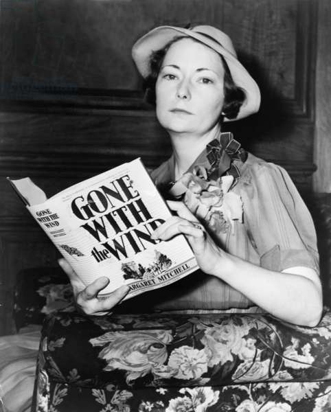 Margaret Mitchell (1900-1949), holding her novel,