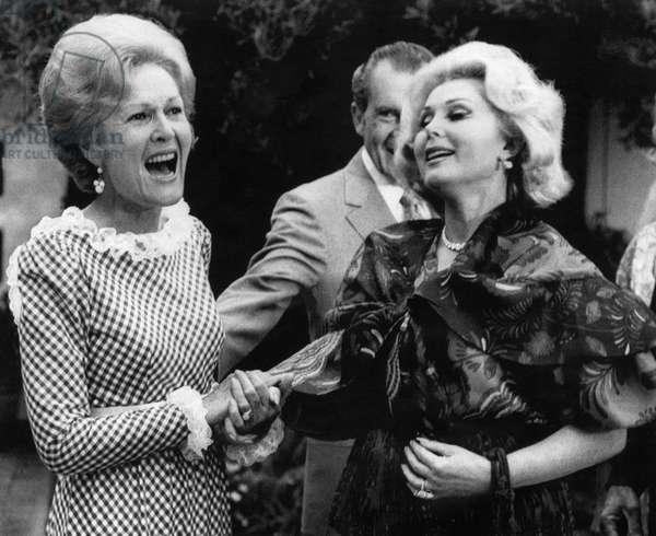 First Lady Patricia Nixon with Zsa Zsa Gabor. (background: President Richard Nixon), in California, 1972