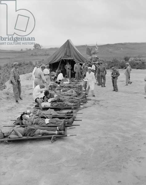 Litter cases of North Korean War POWs are exchanged during Operation Little Switch. They are at the Communist receiving center at Panmunjom, Korea. April-May, 1953. Korean War, 1950-53