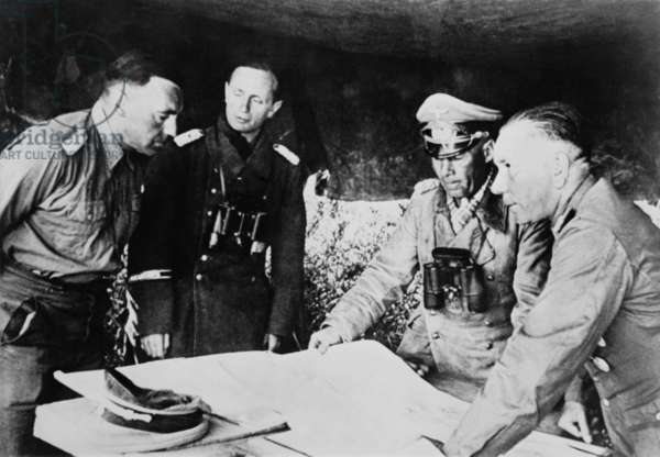 Field Marshal Erwin Rommel confers with his staff on the Libyan front, July 1942. He was fighting the British in the First Battle of El Alamein, July 1-27, 1942, which halted the German advance toward the Alexandria and the Suez Canal