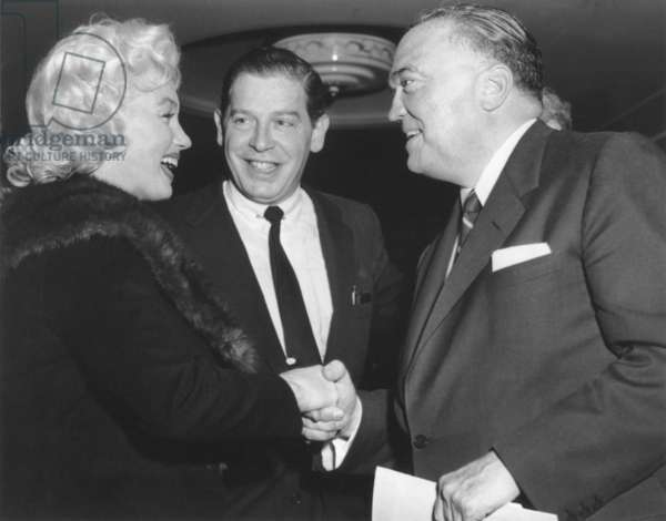 FBI Director J. Edgar Hoover shaking hands with Marilyn Monroe. With Milton Berle, they attended a Banshee Lunch, at the Waldoff Astoria, New York City. The Banshees were a New York City Luncheon group made up mainly of artists, writers, and editors. April 26, 1955