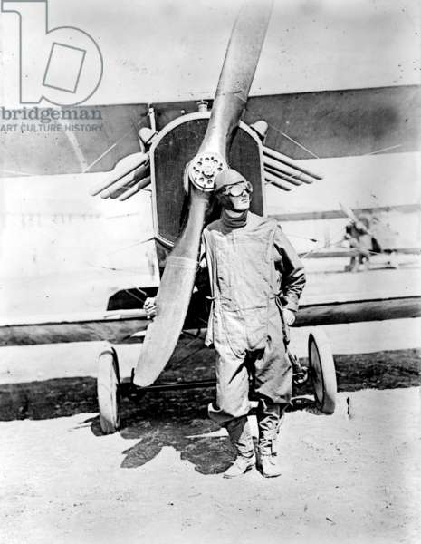 Pilot standing in front of U.S. Army airplane during World War I, c.1918