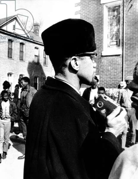 Malcolm X visits the voting rights protest in Selma, Alabama. He is about to photograph the church in which he spoke to protesters. Feb. 4, 1965