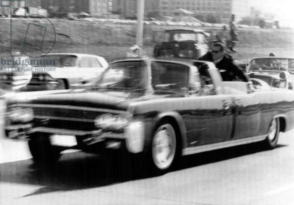 President John F. Kennedy is rushed towards Parkland Hospital after he's hit by an assasin's bullet, November 29, 1963, Dallas, Texas