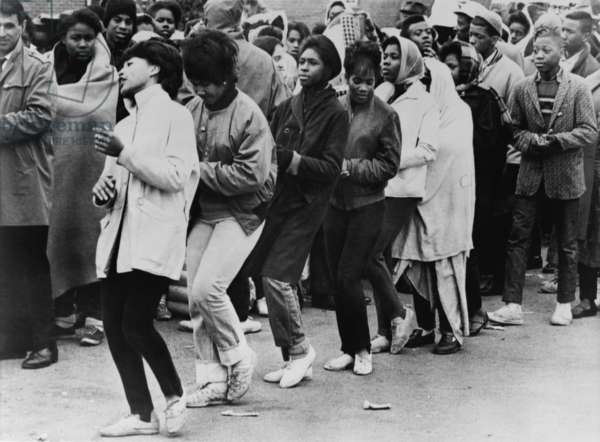 African American women dance at a civil rights demonstration. Over the first three weeks of March 1965, the Selma 'occupation' grew to 8,000 protesters, before they left on the Selma-Montgomery March of March 21