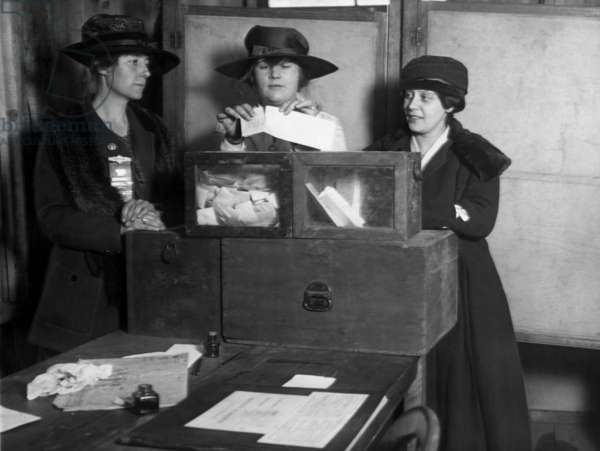 Three women's suffragists casting votes in New York City, c. 1917