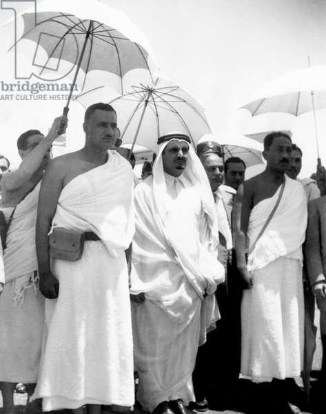 President of the United Arab Republic Gamal Abdel Nasser (forground, left), visiting King Saud of Saudi Arabia (with goatee) during Nasser's pilgrimage to Mecca, 1954.