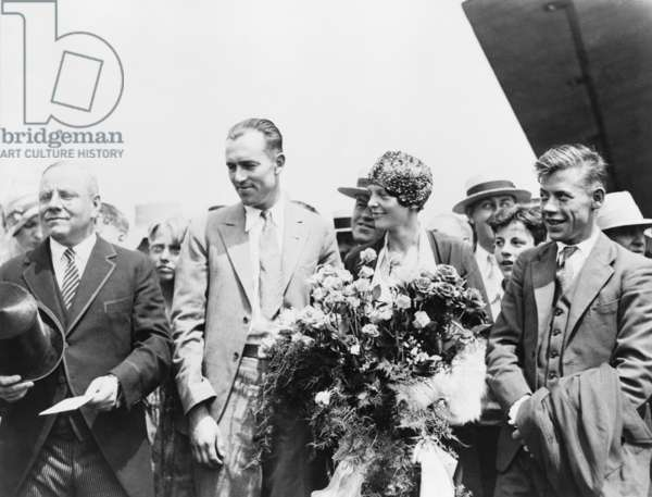 Mayor Malcolm Nichols, greets flyers Lou Gordon, Amelia Earhart, and Wilmer Stultz, as they arrived in Boston, Massachusetts, following trans-Atlantic flight in 1928. A crowd of 300,000 turned out to celebrate the flyers