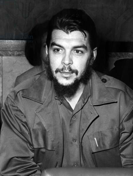 Ernesto 'Che' Guevara steps off a plane in Havana, Cuba, after a three month propaganda tour of the new African nations, March 15, 1965