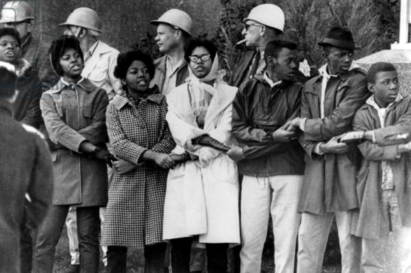 Demonstrators lock arms in front of the Dallas County courthouse in Selma, Alabama. Sheriff Jim Clark had them all arrested, 1965