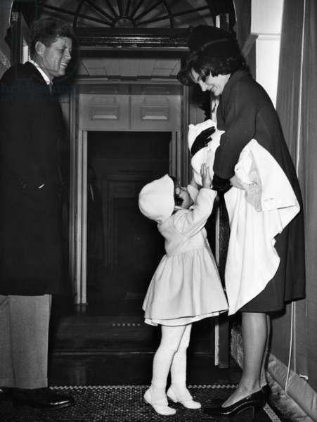 John F. Kennedy, Caroline Kennedy, Jacqueline Kennedy holding John F. Kennedy Jr., January, 1961