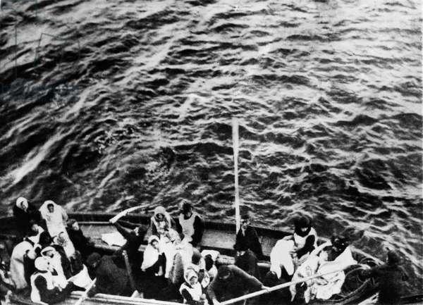 Titanic. A boatload of Titanic survivors pulls alongside the liner Carpathia, April 15, 1912