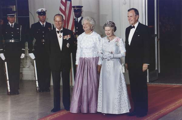 President George and Barbara Bush stand with Queen Elizabeth II and Prince Philip before a state dinner in honor of the Queen. May 14 1991