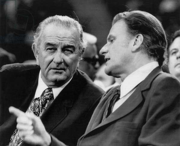 Former President Lyndon Johnson, evangelist Billy Graham, before Graham spoke at Texas Stadium, Irving, Texas, September, 1971