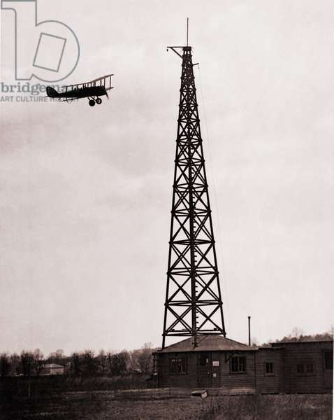 First radio beacon station, with the operating shack and antenna system at College Park, Maryland. Airplane used the radio signals for navigation. 1928