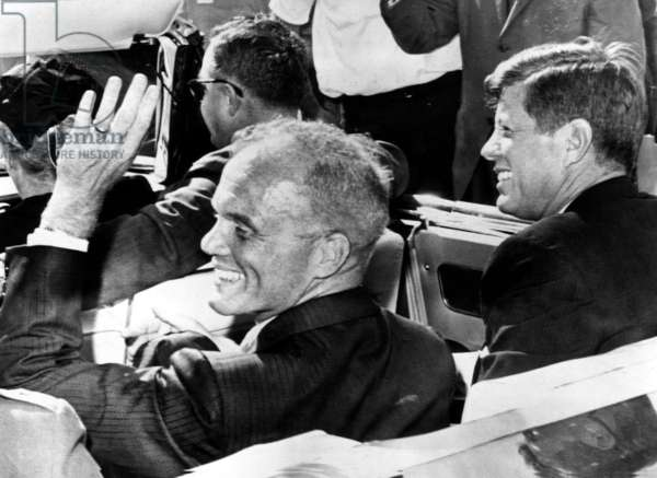 Astronaut John Glenn and President John F. Kennedy wave and smile to a cheering crowd.Cape Canaveral, Florida, February 23, 1962