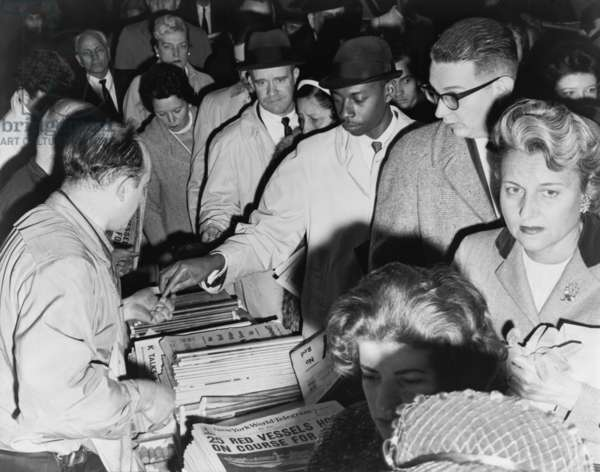 Anxious New Yorkers buying newspapers during the Cuban Missile crisis. October 1962