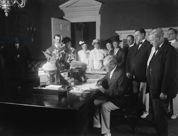 Woodrow Wilson signing the Child Labor Law of 1916, prohibiting interstate commerce of goods made using child labor. The law was stuck down by the Supreme Court for violating a child's right to contract his work