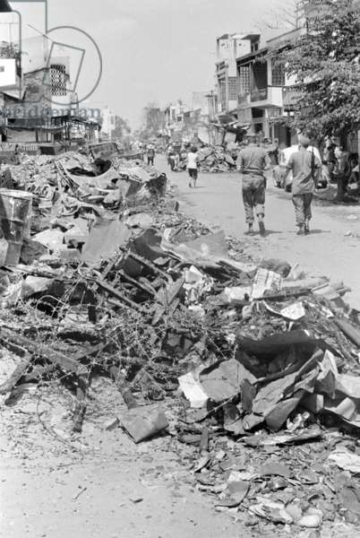 Vietnam War, Saigon, Vietnam, rubble and the remains of barbed wire line the streets of Cholon, a suburb of Saigon that was burned by South Vietnamese army troops in an effort to flush out any Viet Cong that remained after the Tet offensive, c.1968
