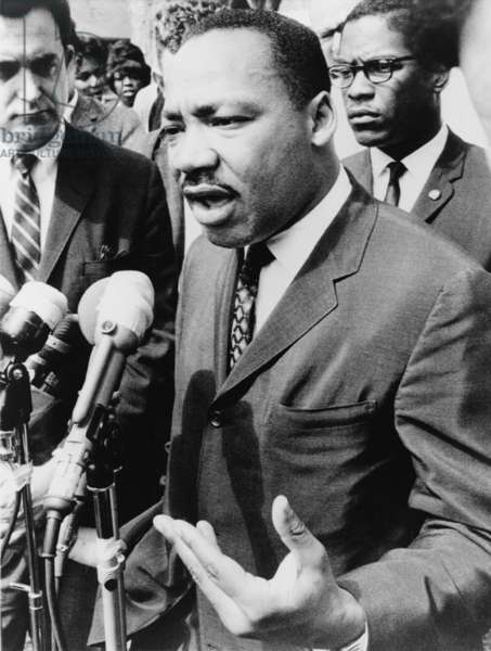 Martin Luther King, Jr. (1929-1968), speaking at an informal news conference in Selma, Alabama, 1965