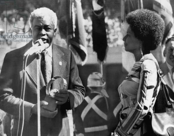 Former Brooklyn Dodger Jackie Robinson and wife Rachel Isum Robinson, accepting 25-year award during Game 2 of the 1972 World Series, October 15, 1972
