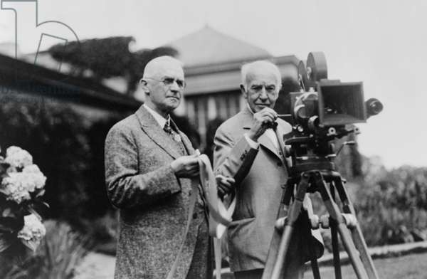 Thomas Edison 1847-1931 and George Eastman 1854-1932 standing with motion picture camera c. 1925
