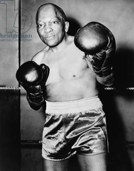 Former Heavyweight champion Jack Johnson in boxing pose. c. 1930s.