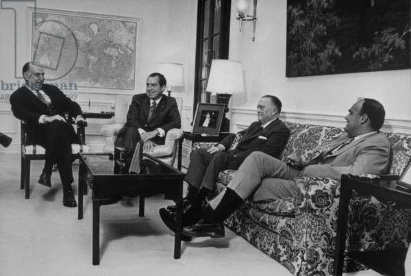 President Nixon conferring with Attorney-General Mitchell FBI Director J. Edgar Hoover and John D. Ehrlichman. c. 1969-1972
