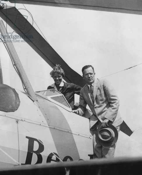 Amelia Earhart greeted by her husband George Palmer Putnam on her return to Newark Airport, New Jersey after a trans-continental flight. June 22, 1931.