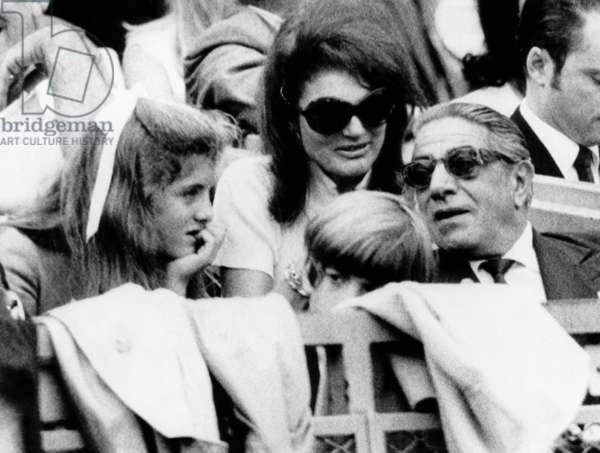 Caroline Kennedy, John F. Kennedy Jr., Jacqueline Onassis and Aristotle Onassis watch the World Series, 1969