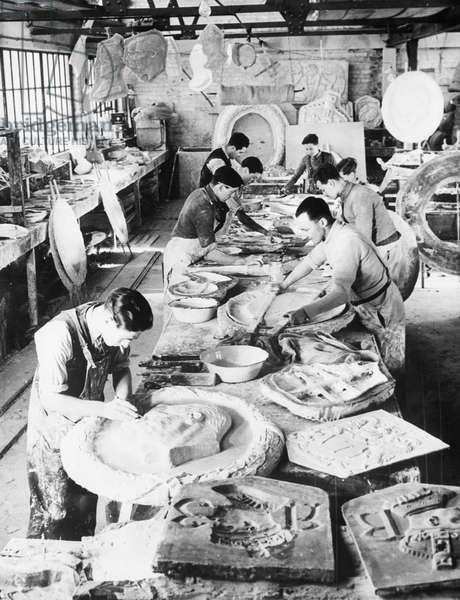 Sculptors making images of King George VI, and his wife Queen Elizabeth, for the coronation, England, December 23, 1936